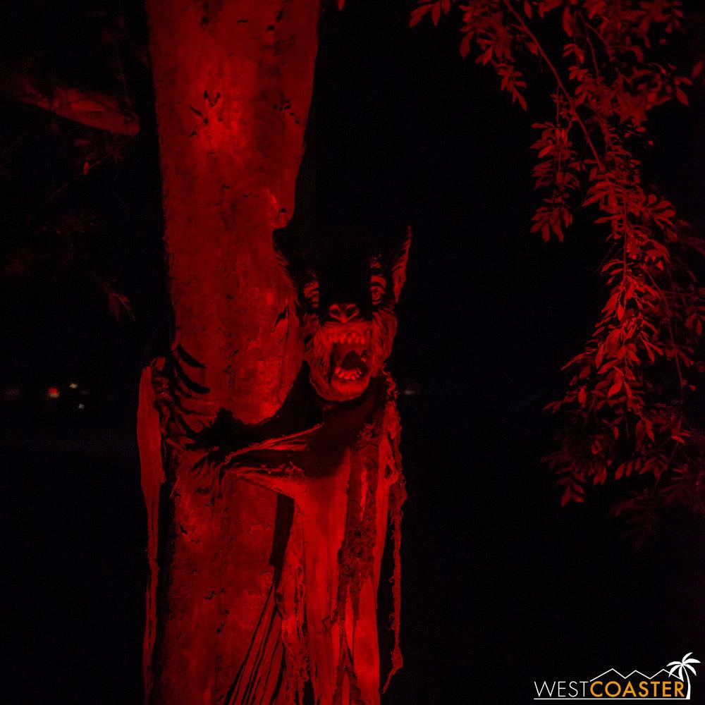 A werewolf peeks behind a tree, eyeing the meal.