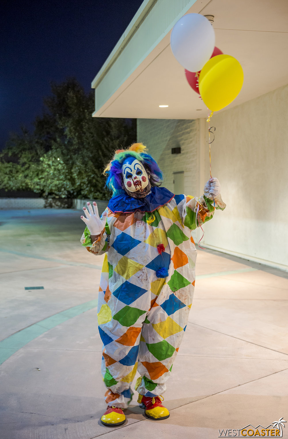 What a nice, adorable, friendly, super innocent, completely harmless looking clown with balloons!!