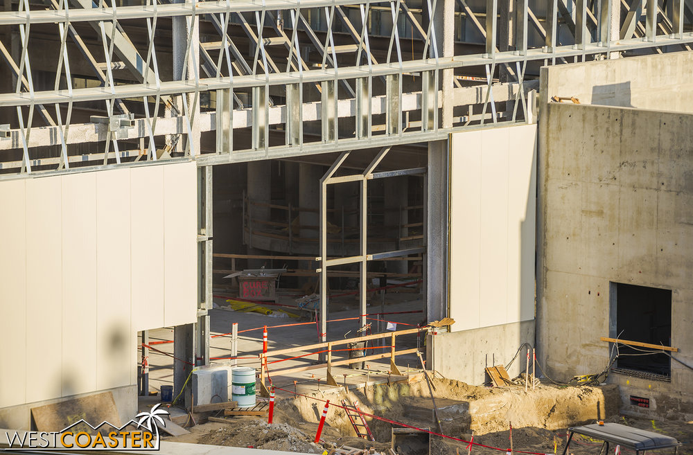 "Looks like there will be another large maintenance opening provided here, though.  Possibly a large roll-up or sliding barn door here.  A smaller man door to the left can be seen in the outline of what's been ""cut out"" of the wall paneling."