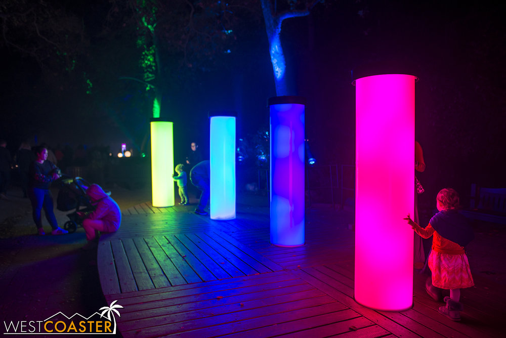 Guests are invited to touch these cylindrical color columns, altering the light and hue and changing how the surrounding trees are perceived.