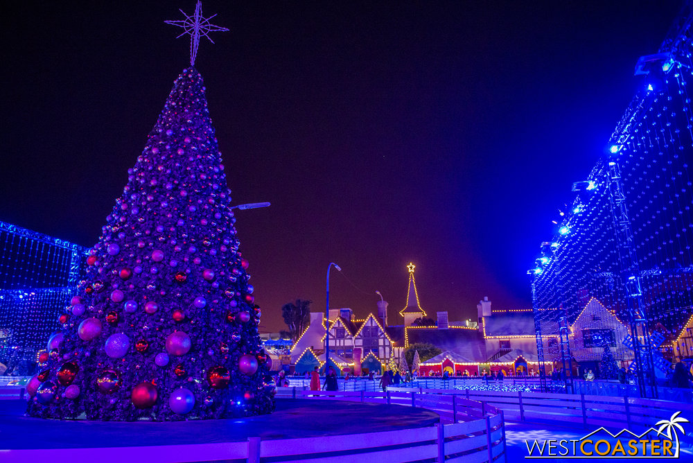 The Christmas tree, with light rigs and the Village in the background.