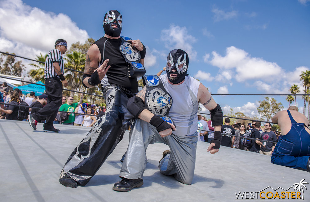 "Lucha libre wrestling was in fast action.  Fun fact: one of these two is actually ""Evil,"" leader of the Queen Mary's Dark Harbor slider group."