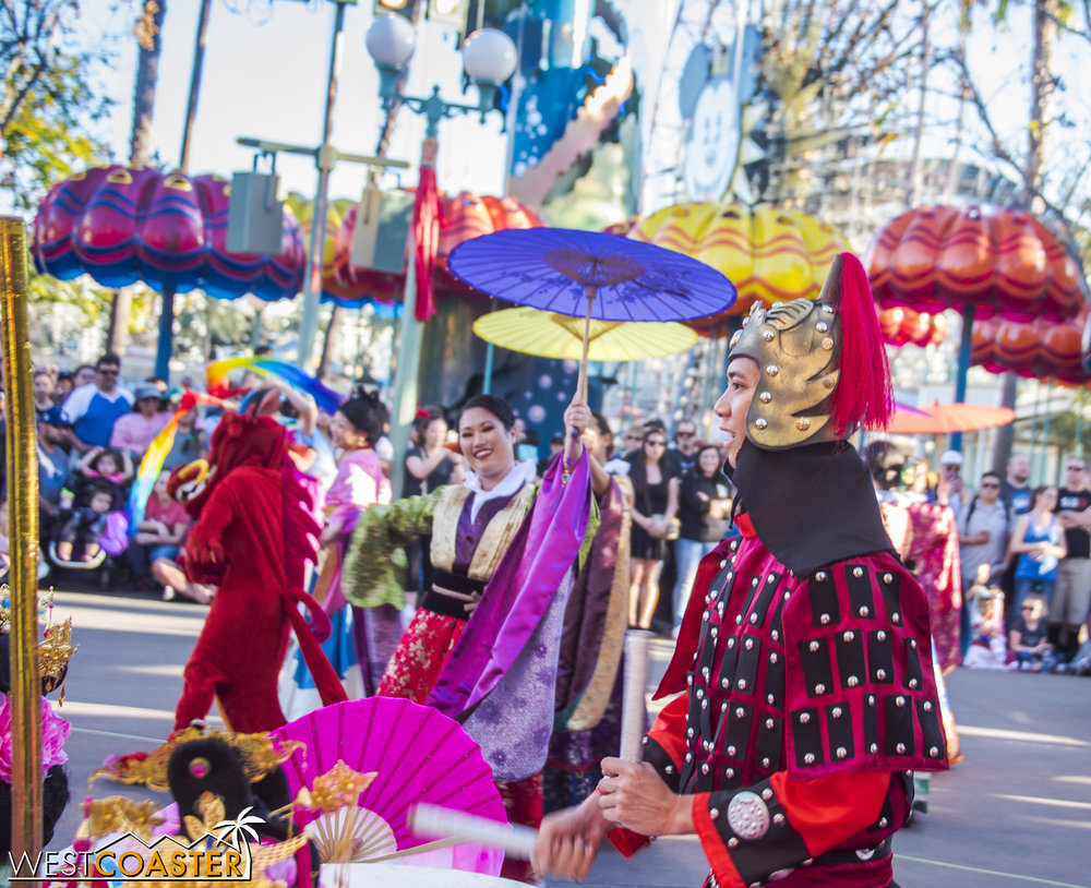 There is a lot going on during this mini-parade celebration of Chinese New Year.