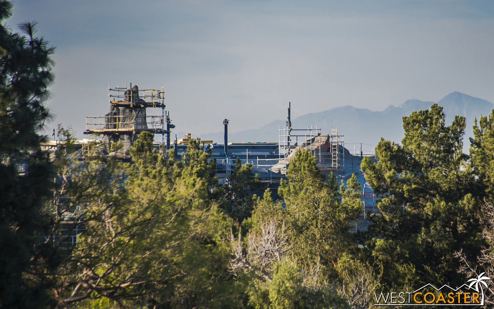 The rockwork is finally tall enough to poke above the treeline and be seen from Tarzan's Treehouse.