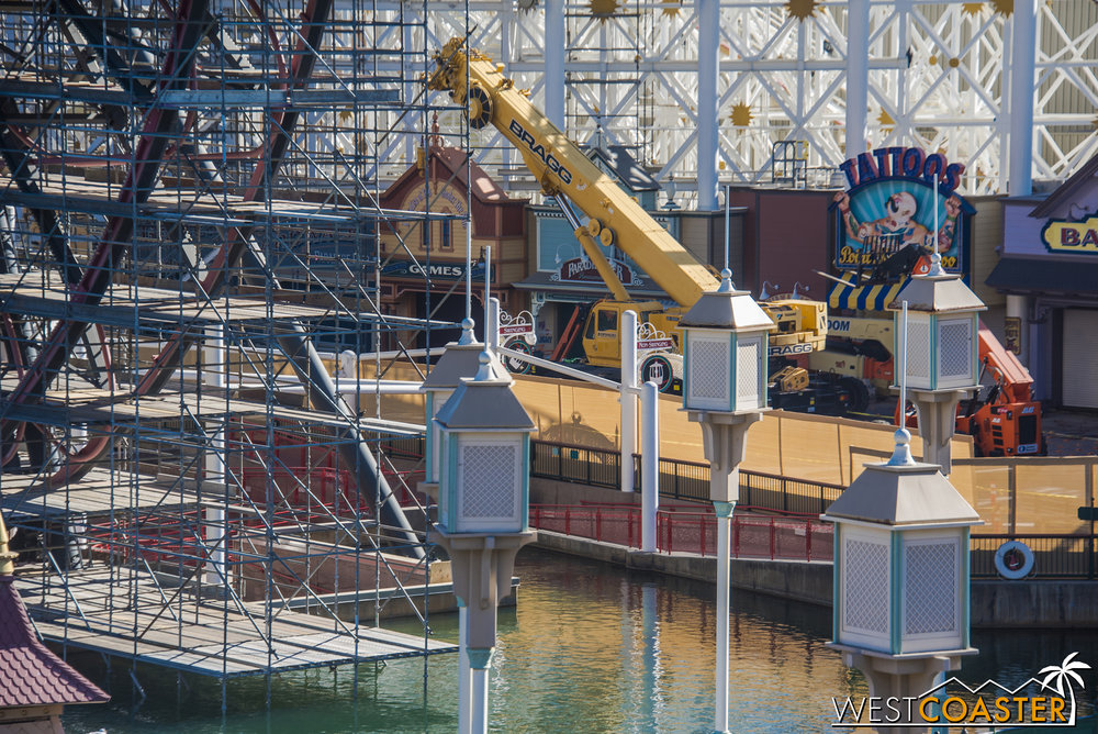 A crane has shown up over by the midway games.
