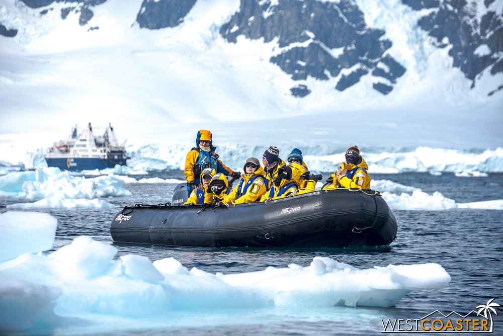 A Zodiac raft cruises between bits of sea ice.