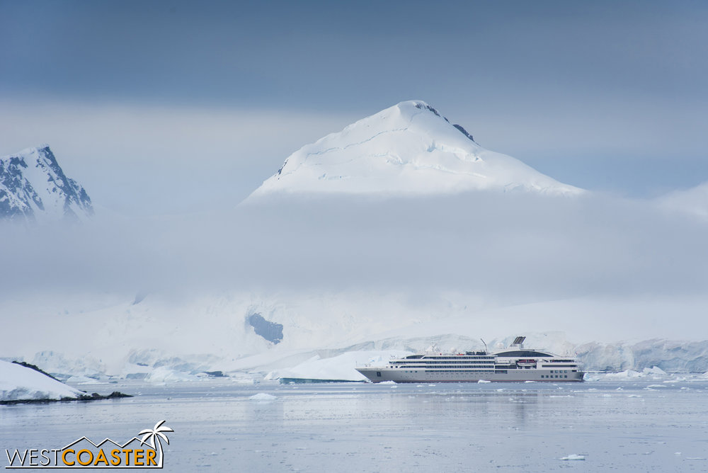 A distant ship from another Antarctic cruise operator waits for us to leave at a far end of the harbor.