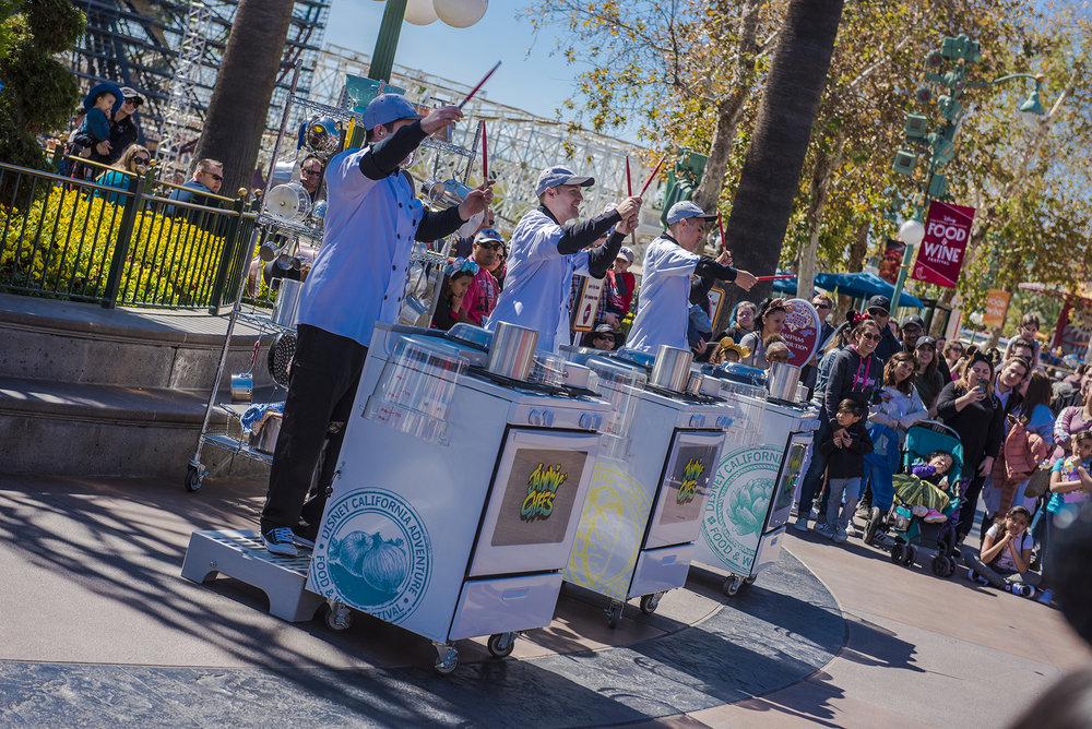 Jammn' Chefs create a partying percussion of pots and pans adjacent to Paradise Park.