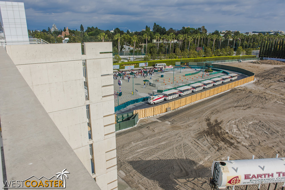 As of at least earlier this week, the only paved area south of the Mickey and Friends Parking Structure was the old tram loading area, which is now the unloading area.