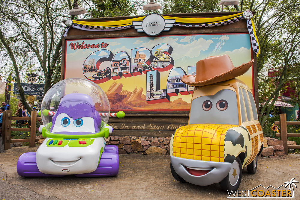 "There are some new but familiar vehicles over at by the ""Welcome to Cars Land"" sign."