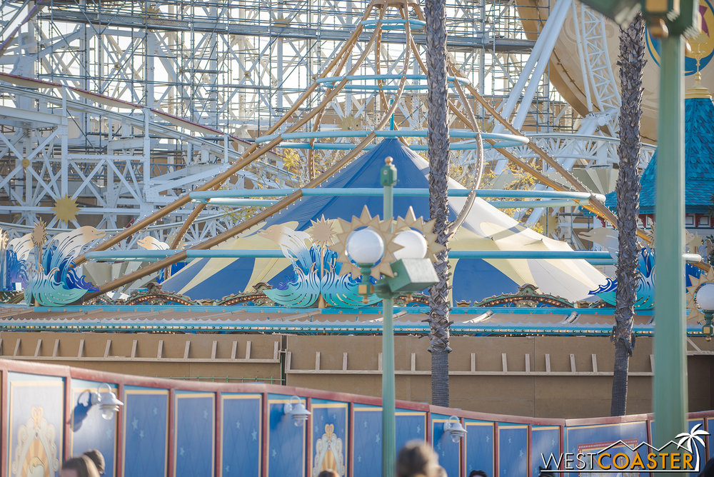That will make the ride less open, though.  But perhaps the inside of the wall will have a fun painting or perhaps animation or zoetrope effect for guests circling by?