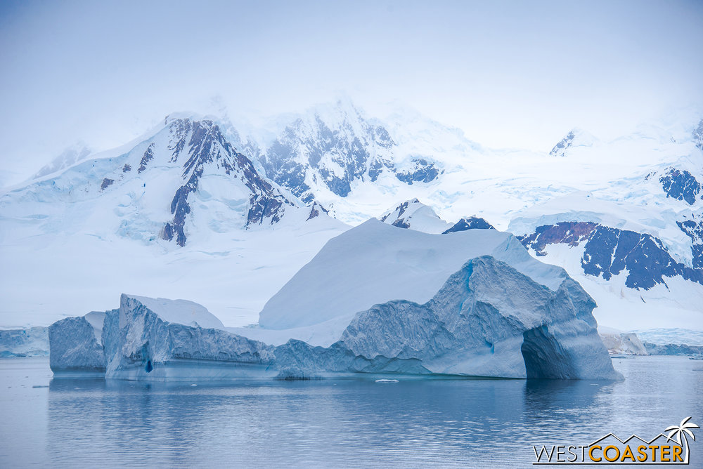 Cavernous icebergs float by as the  Ocean Diamond  continues its journey.