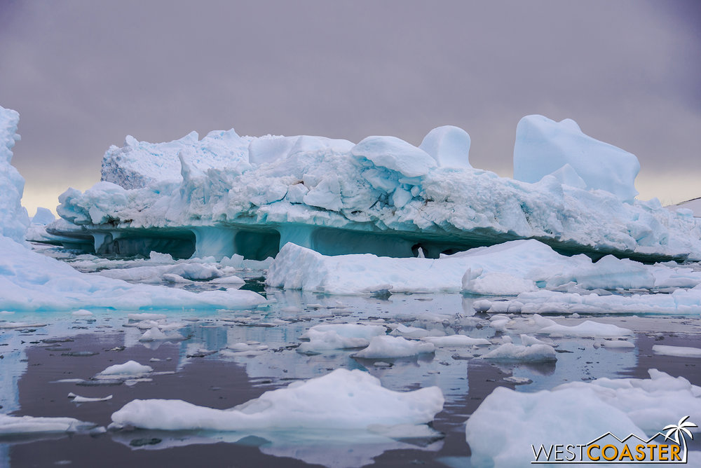 As icebergs melt, they center of balance shifts, and the underwater erosion can surface to produce some very fascinating sights.