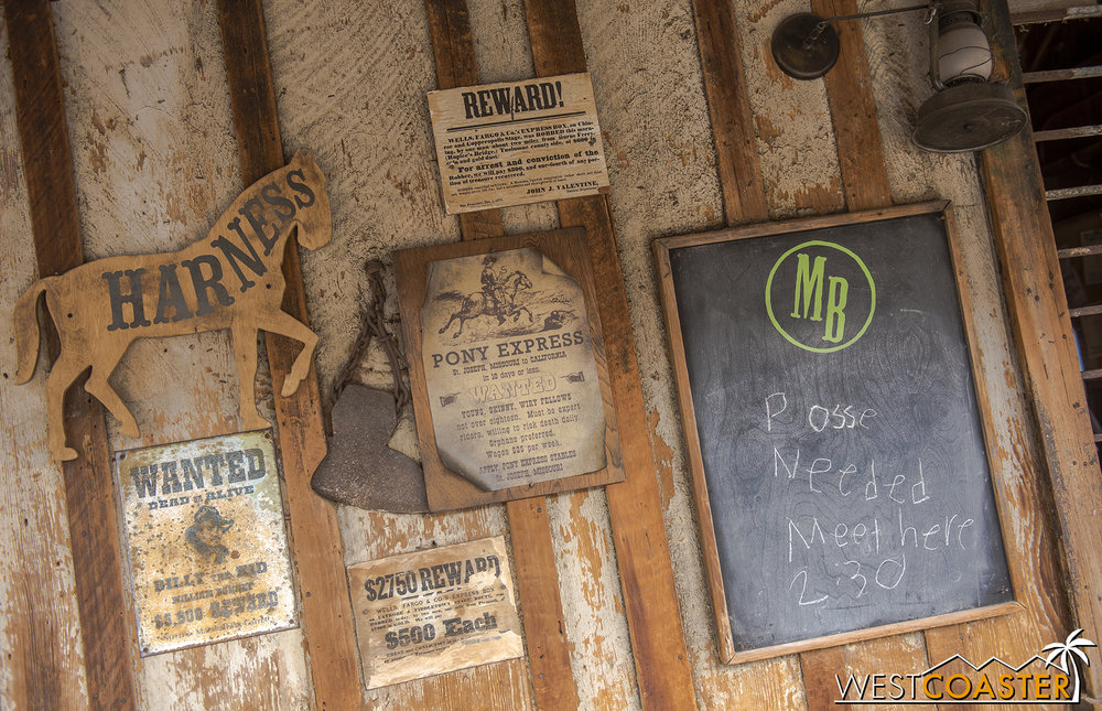Signs and details everywhere set the ambiance for the Ghost Town Alive! environment.