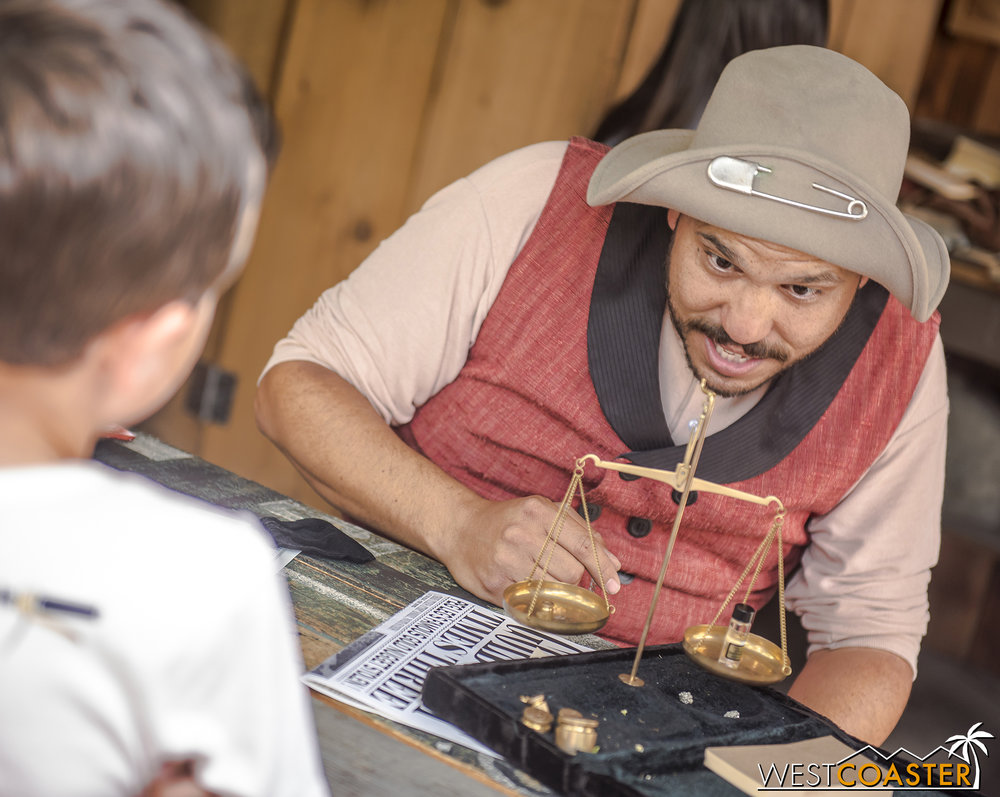 """Peg Leg"" Cinch ascertains the value of gold that a young guest has brought to be assayed."