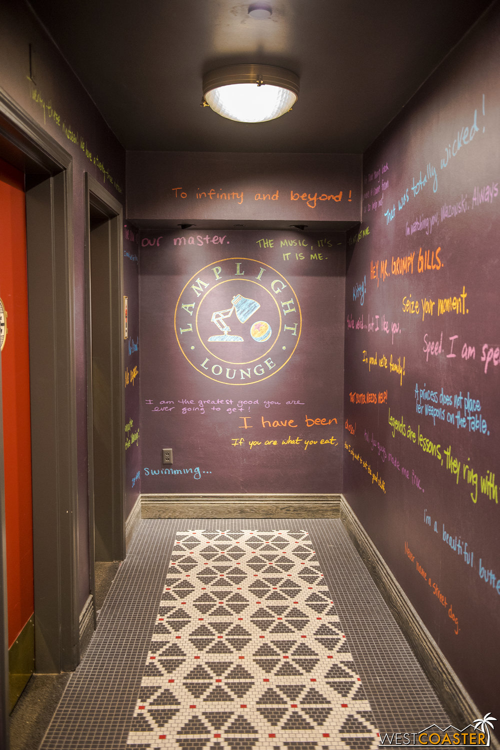I kind of love this hallway to the restrooms.  Pixar quotes everywhere.  A lovely way to spruce up an otherwise boring passageway.