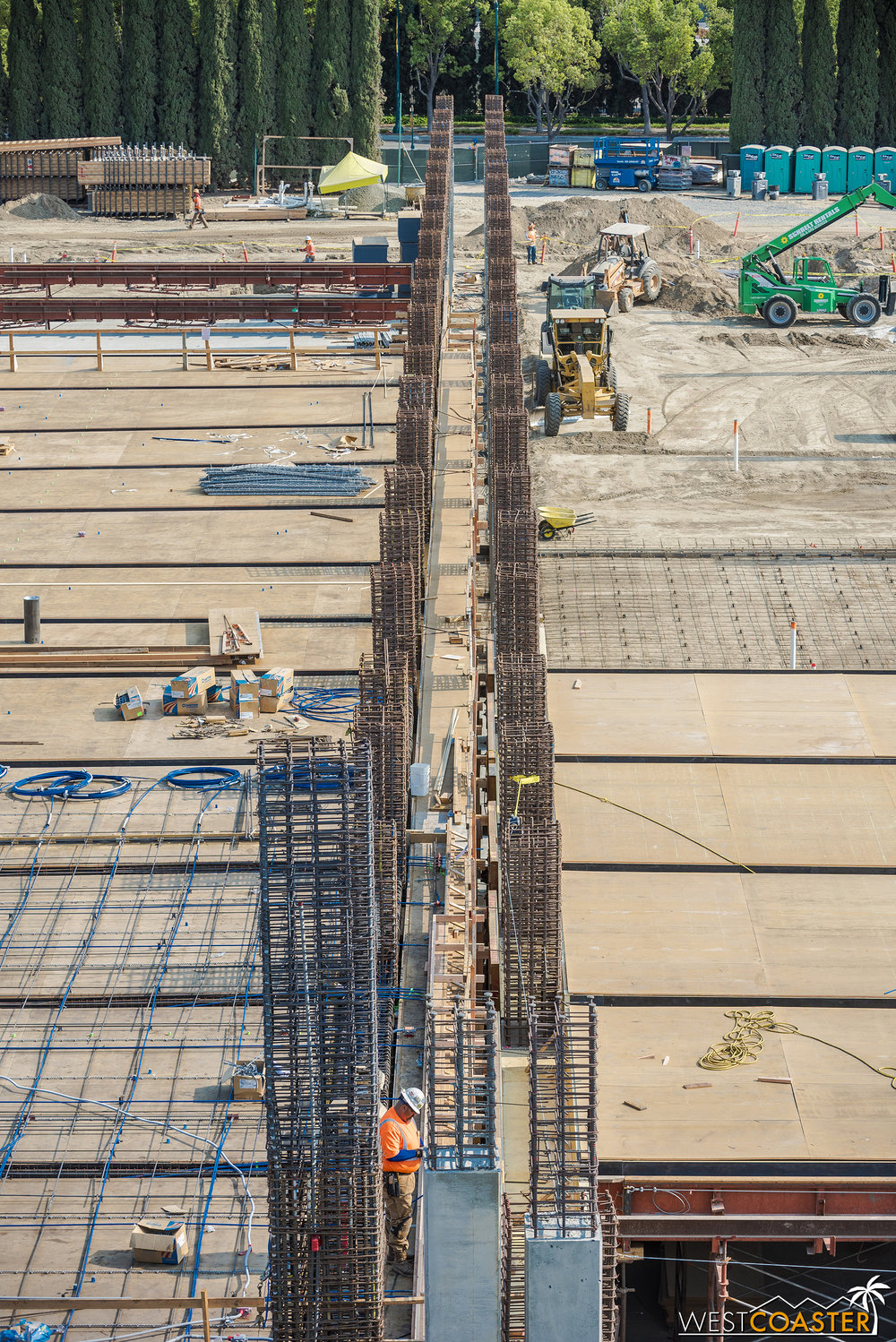Down the line of the seismic separation again, with more rebar.  Rebar gives concrete reinforcement and helps it behave strongly in tension; the concrete itself is very strong in compression.  Together, they form a durable and flexible structural frame.