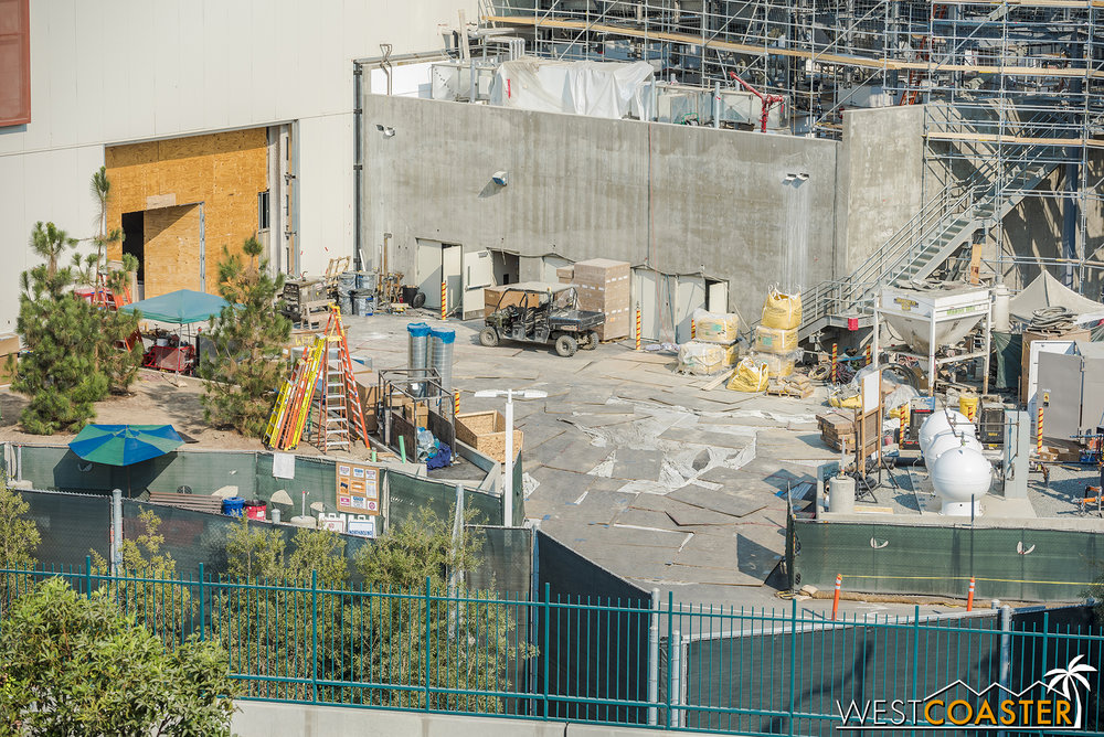 They continue to close up the giant opening into the First Order ride building.