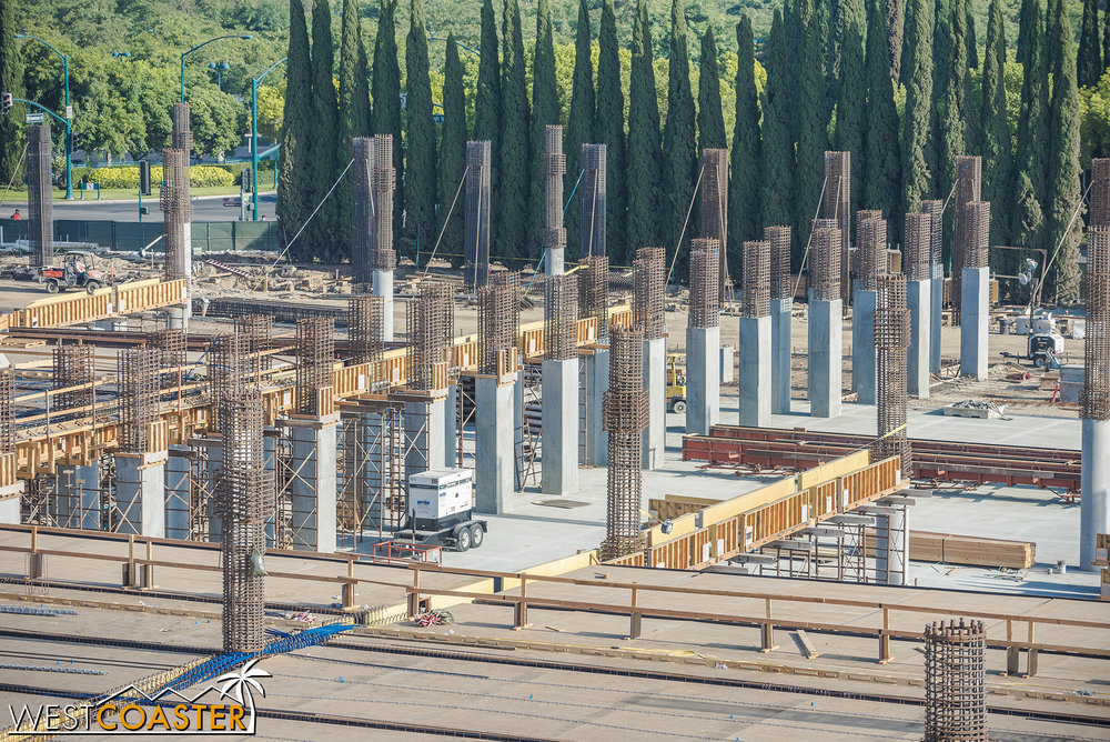 The double row of columns continuing.  I couldn't see any opening for a series of exit ramps like there currently are in the existing structure, but the connecting bridges now show us why.