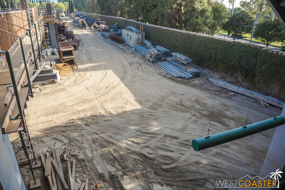 Looking down below.  This used to be where cars with disable placards turned into the Chip & Dale lot after turning left (instead of right) following the parking toll booths.  Now, cars that don't get routed to the existing structure will turn left here and then go up the ramps.