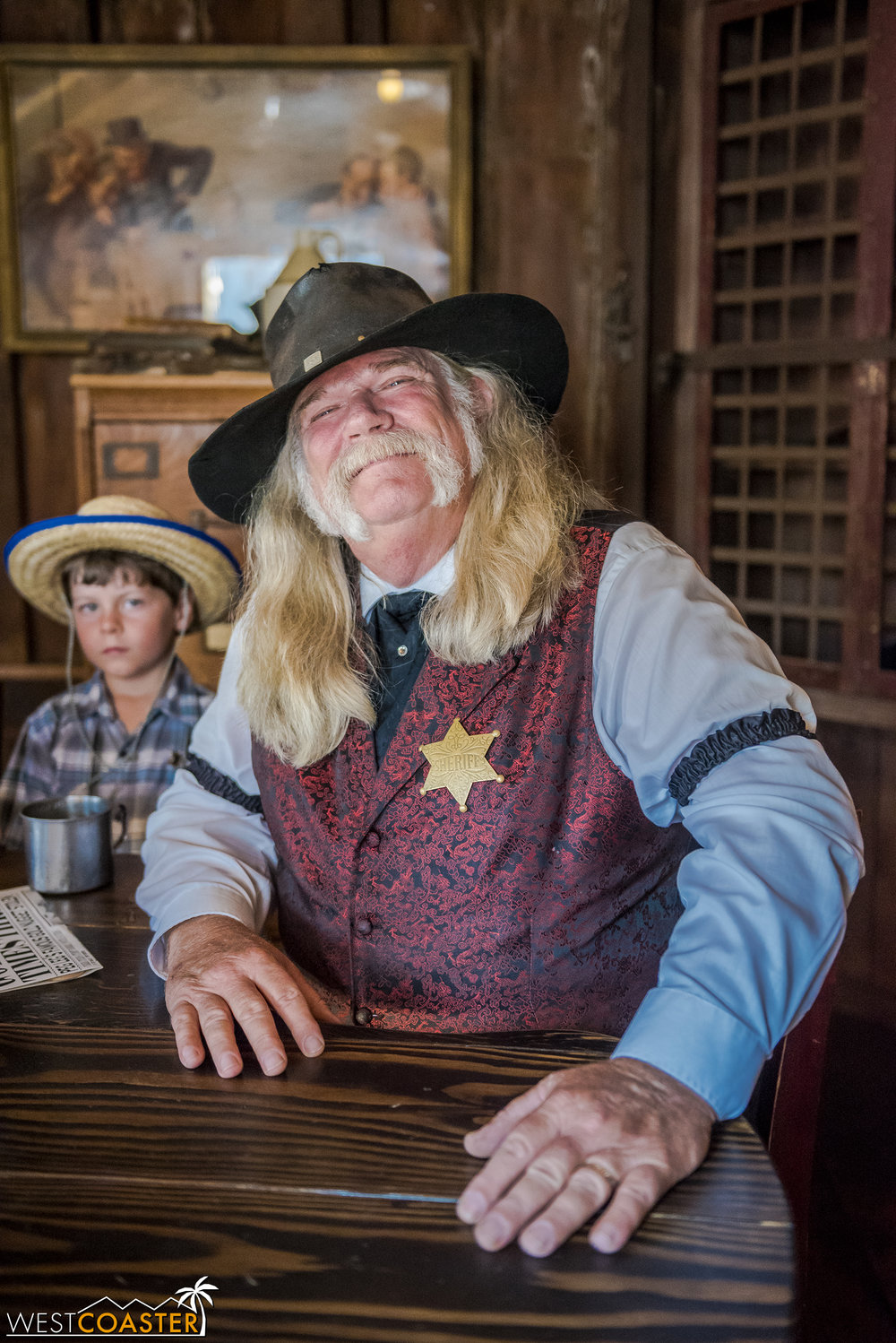 Of course, Sheriff Bryce Wheeler is around as always.  On this day, he's waiting for a stagecoach to arrive carrying his date to the Founder's Day Hoedown, Goldie West.  Unfortunately, the stagecoach has been delayed by three days, much to many people's consternation.