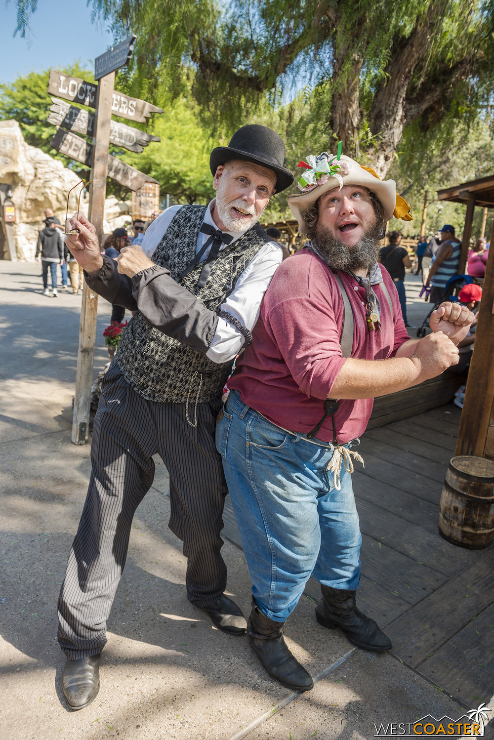 Zeke Connelly (left) and Prospector Flint Stahlek share a silly moment outside of the Assayer's Office.  But Zeke worries about the delayed stagecoach, which is carrying his beloved wife to back to town.