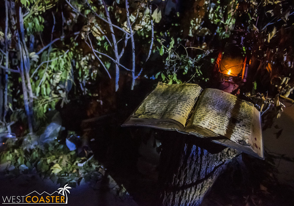 Guests in line hear audio testimonials and soundbites that offer insight into the story of this year's original haunt. Or, they can just read a page from a book lying on a tree stump, which tells the full legend of the witch.