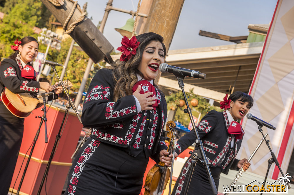 The Mariachi Divas sing classic Christmas songs at Pacific Wharf, next to the Cafe.