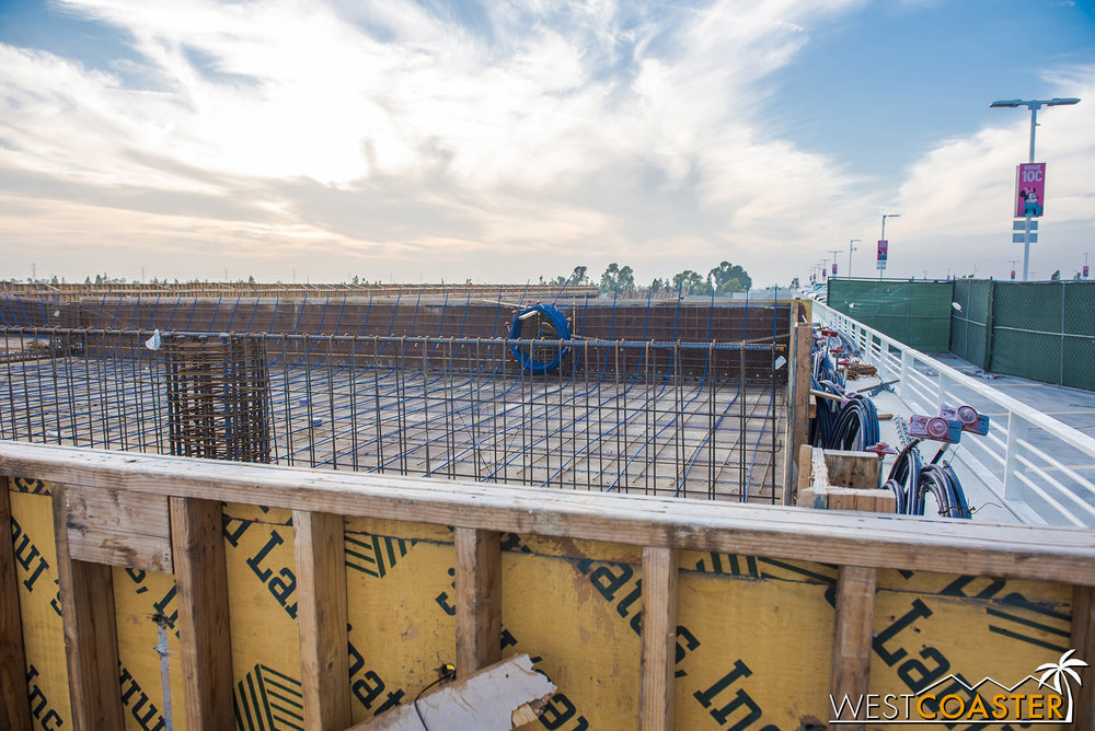 Over at the top floor, it's surprisingly easy to hop over the forming walls and walk onto the new structure.  I suppose common sense against construction site dangers should be enough to deter people from doing so.