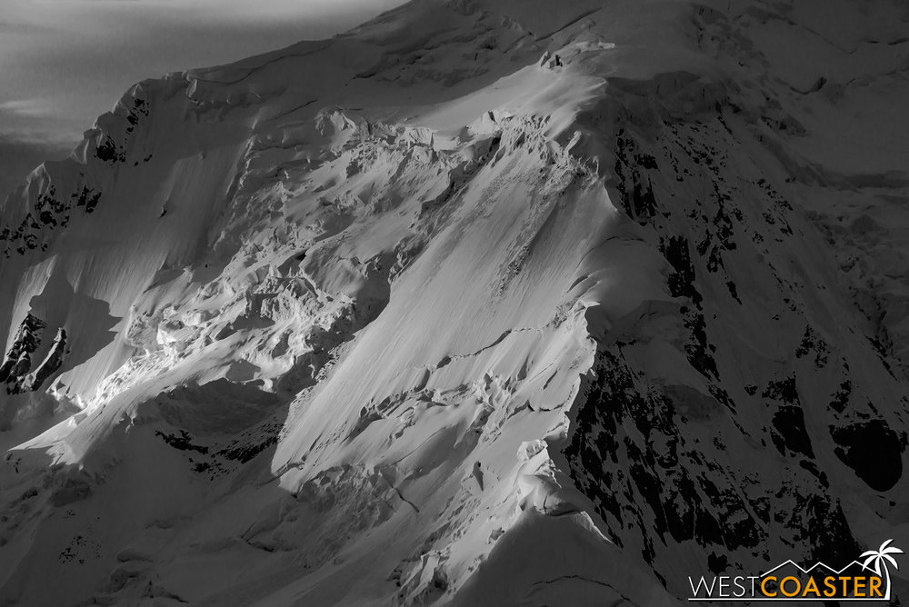 The magnificence of light and shadow projected across an Antarctic mountain face, rendering an indelible memory forever.