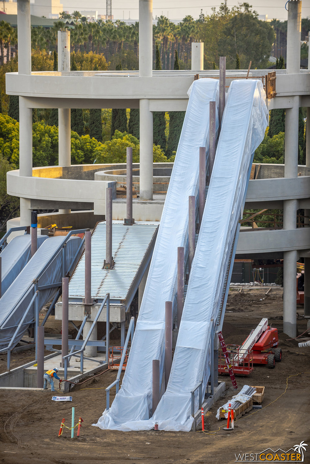 The escalators up to the fifth floor have been installed!  But they remain covered to protect against the weather.