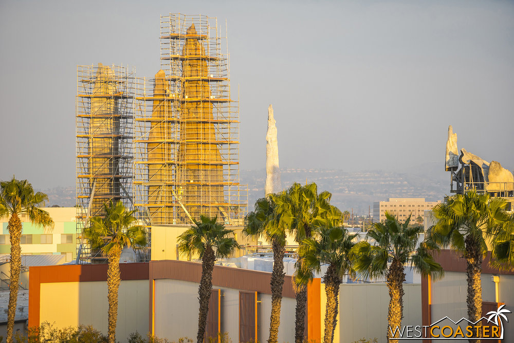 The plaster at these individual spires has been taken down to roof level.