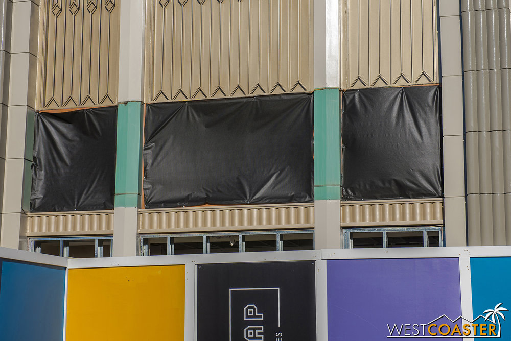 They're changing out wall paneling above the storefront.