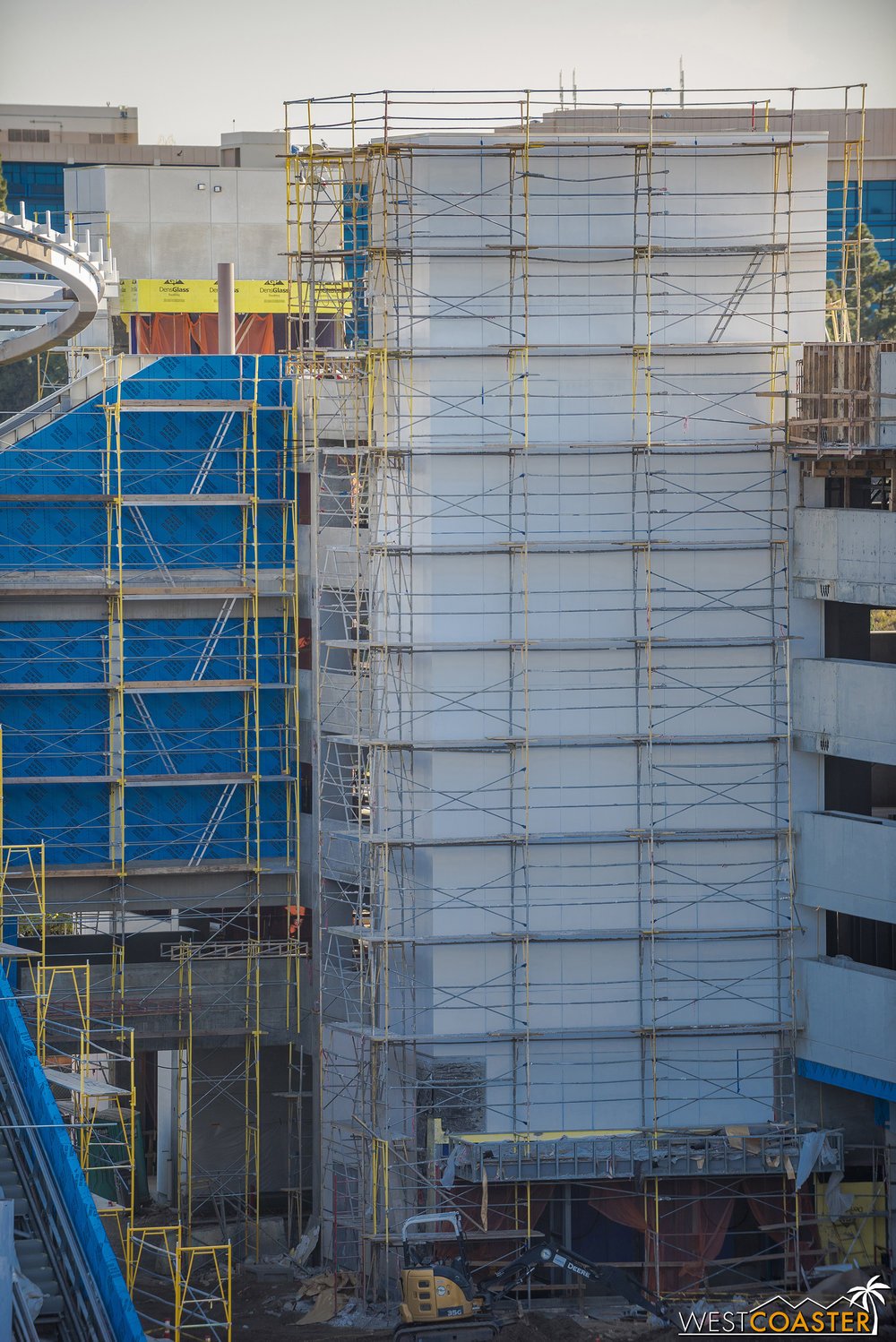 The elevator towers are being wrapped up.  Over in the existing structure, the building material is an aluminum composite metal panel.  But here, it looks like they're using plaster (stucco) with joints to mimic the panel look!