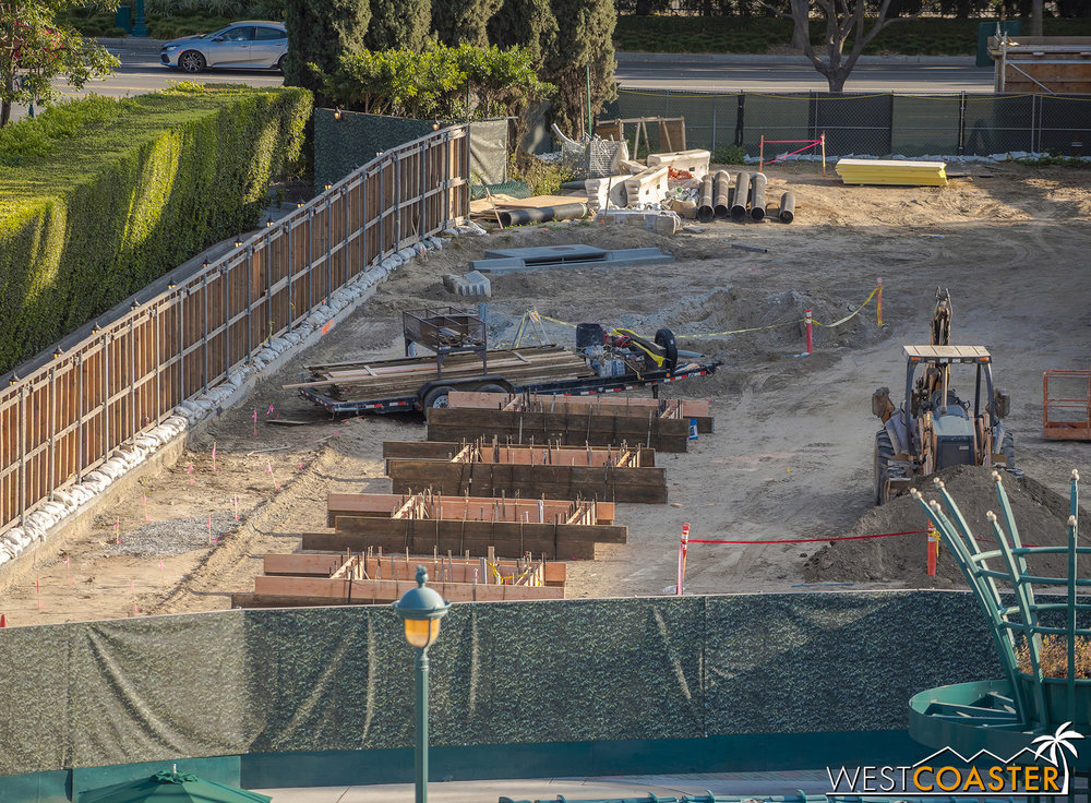 They're also setting up formwork to pour planters.  You may recall that planters used to be here at the tram loading area.