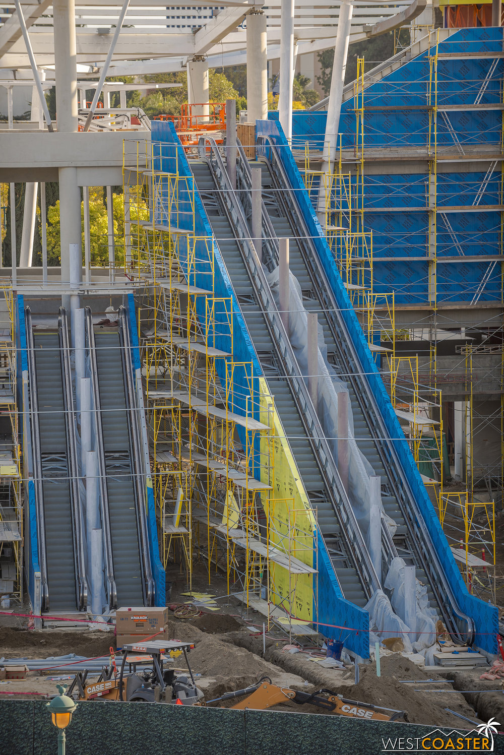 The escalators continue along.  Sheathing has been installed, with metal panel next (unless they're reducing cost and using smooth plaster—more on that in a moment).
