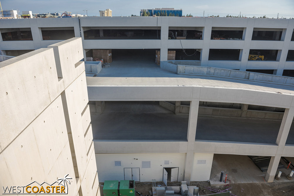 The added structure has its own set of ramps to its levels, to be accessed by turning left after the parking booths and heading toward where the bus and overflow parking used to be.