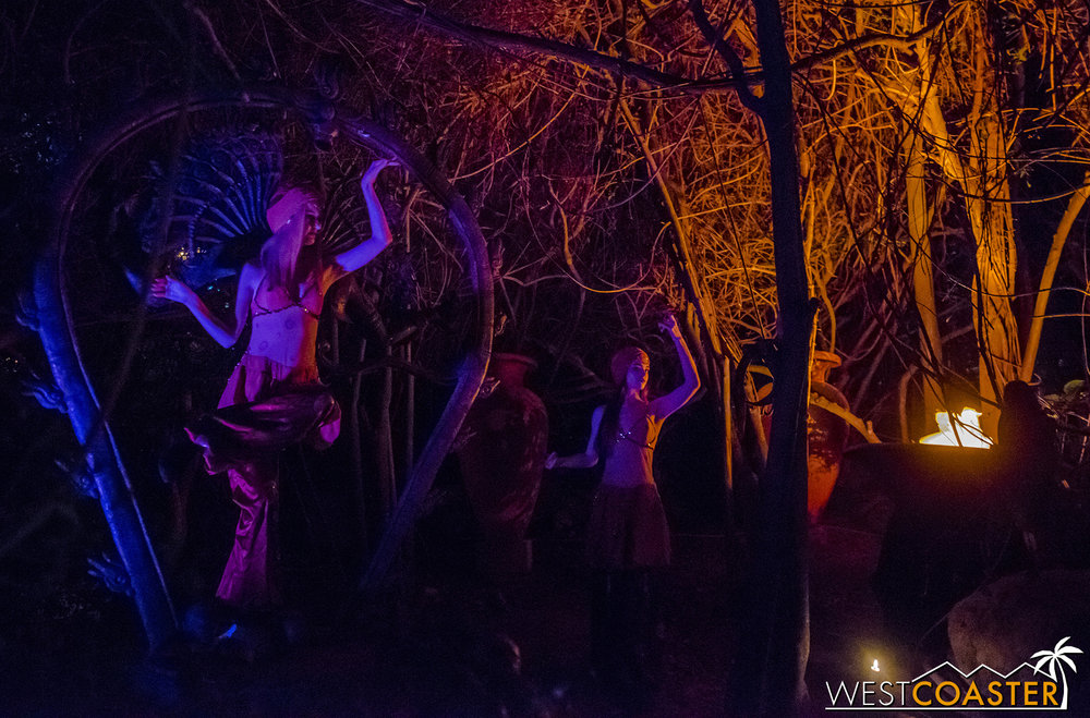 Dancers in the jungle firelight provide a curious display.