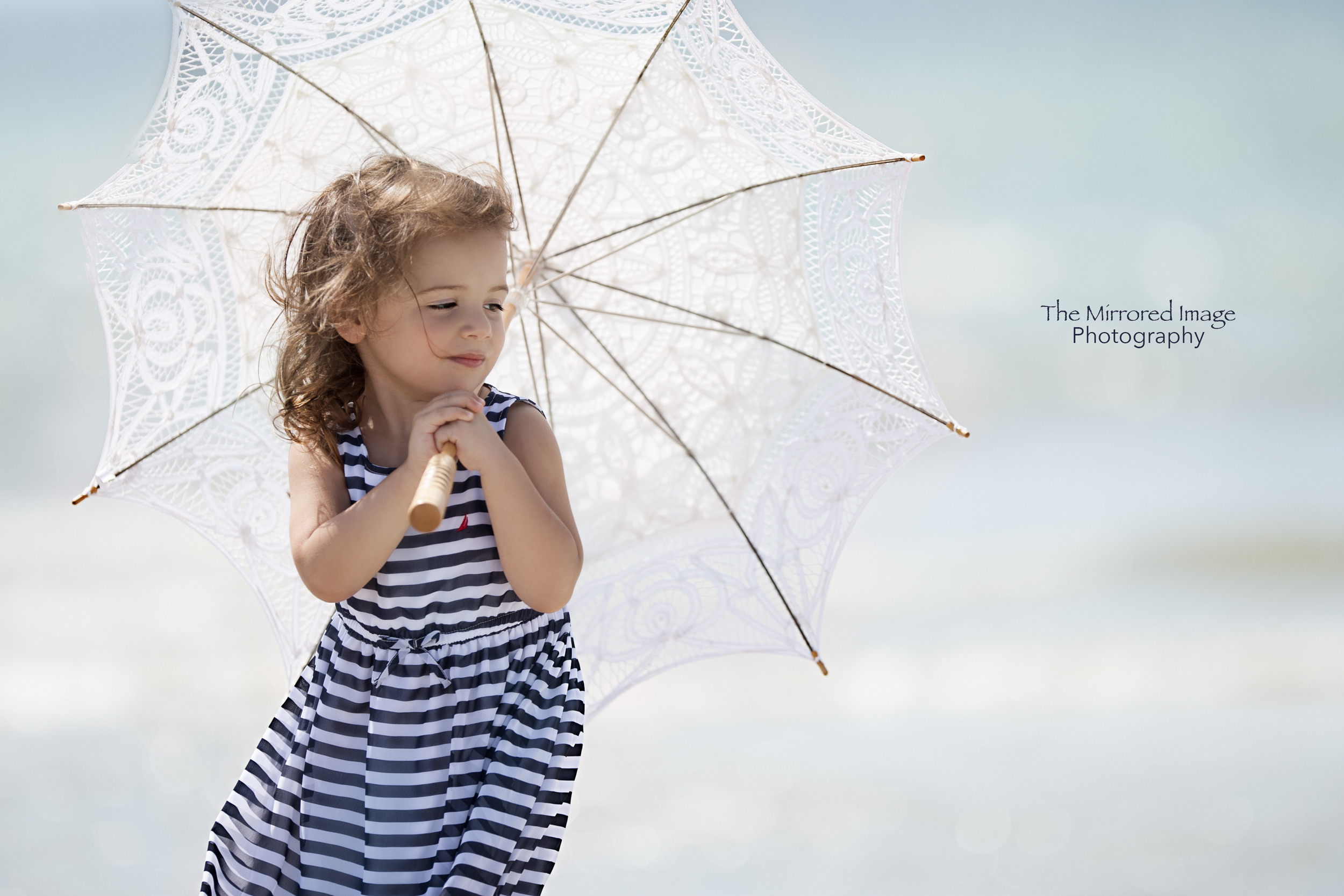 Beautiful beach portraits of little girl