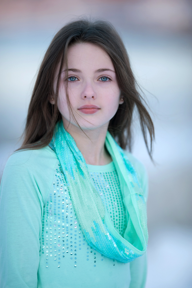stunning Young Tween during winter portrait sesion with bestie,