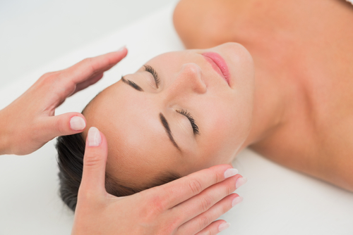 woman receiving reiki treatment at long island spa