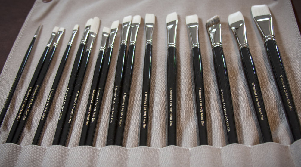 The complete set of brushes ordered + extras and loaded in the handmade leather brush wrap.