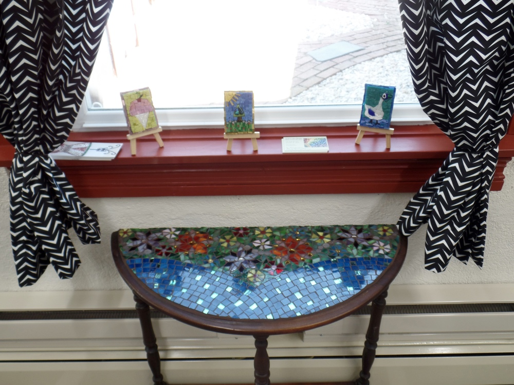 Antique table repurposed with mini-mosaics