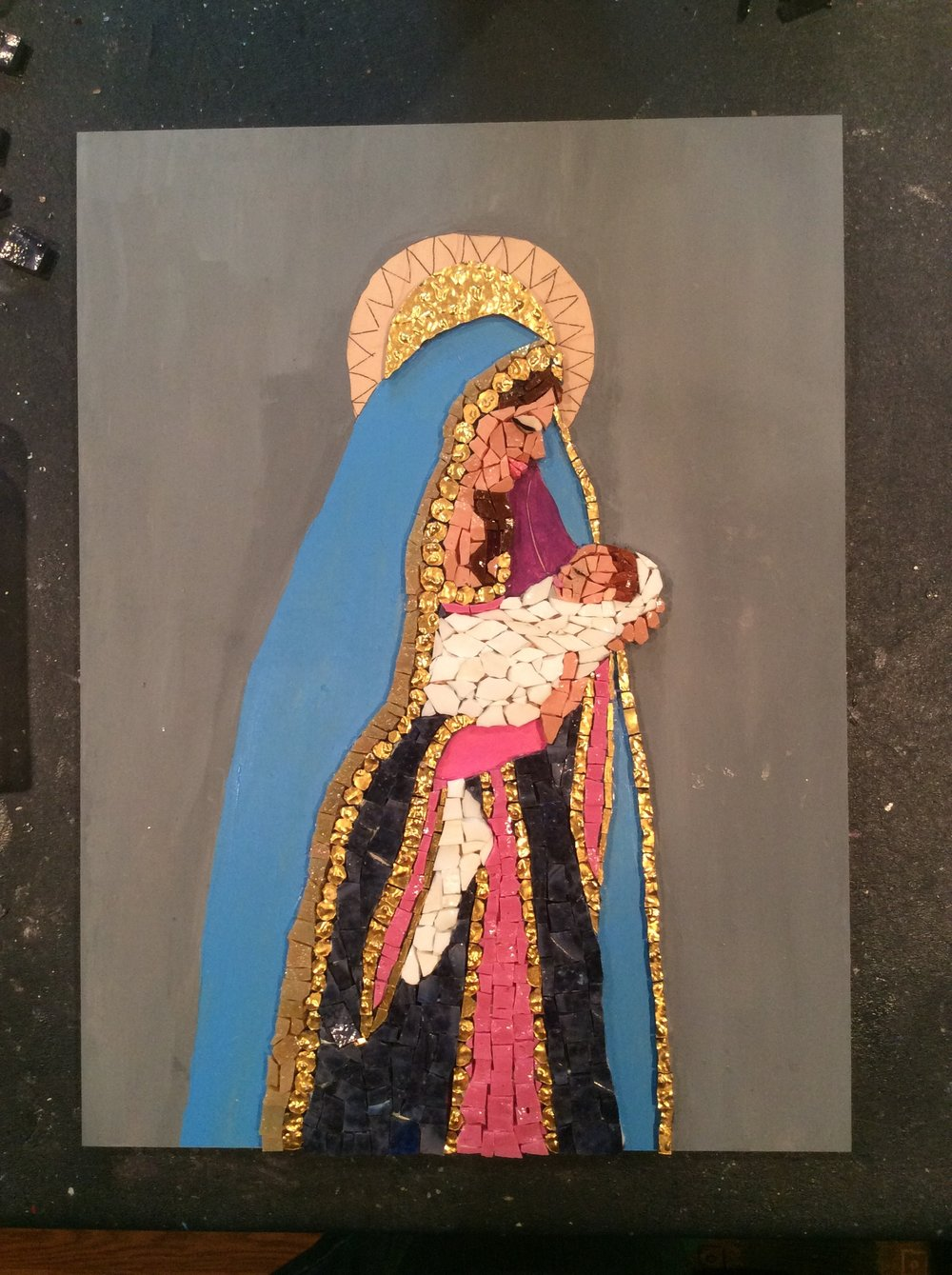 Another 5 hours of work. I have just enough purple smalti to finish the Madonna's dress.