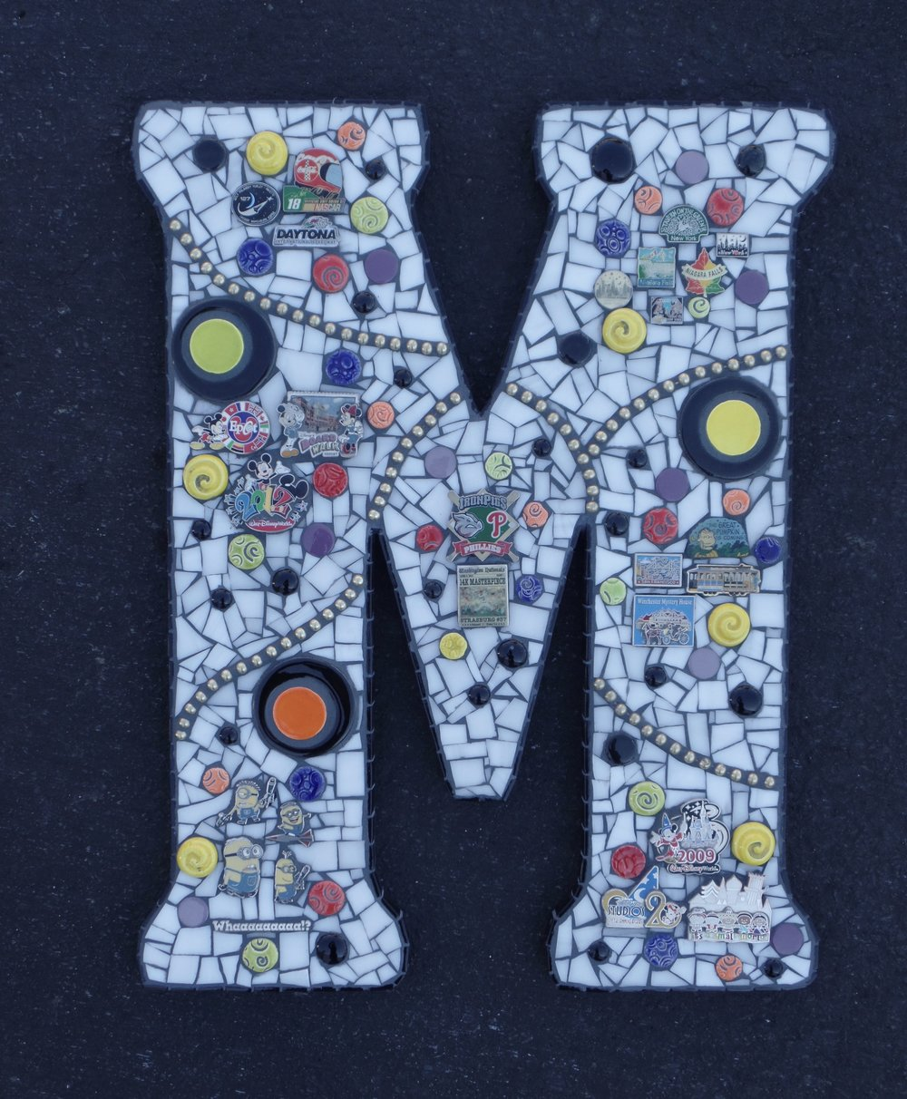 M is for Michael - This initial is designed around pins collected during family vacations.