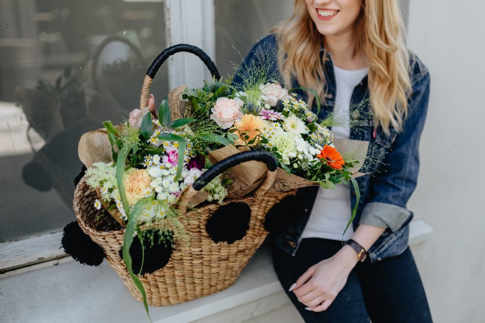 Image source:  https://kaboompics.com/photo/8215/young-woman-with-basket-full-of-flowers