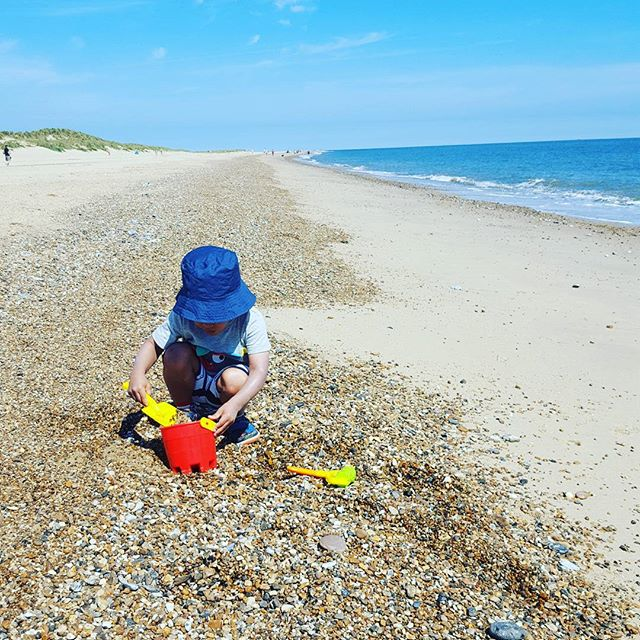 One boy and his beach. Where are your favourite destinations for sand castle building? #summerfun