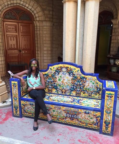 Sitting Pretty on the Royal Bench in the Bangalore Palace courtyard.