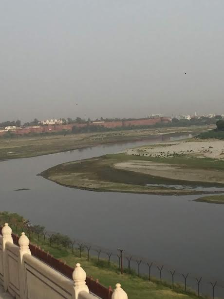 From the Taj, you can see the Yamuna river, and the red bricks in the distance is the Agra Fort.