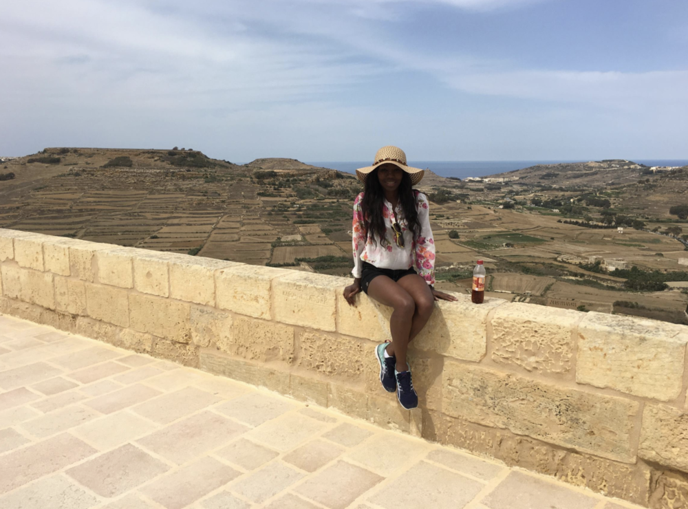 Look at that backdrop (an the cute girl!) - Island of Gozo, Malta.